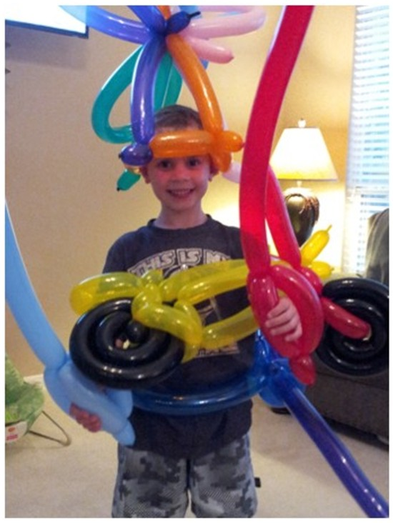 lad with balloon hat